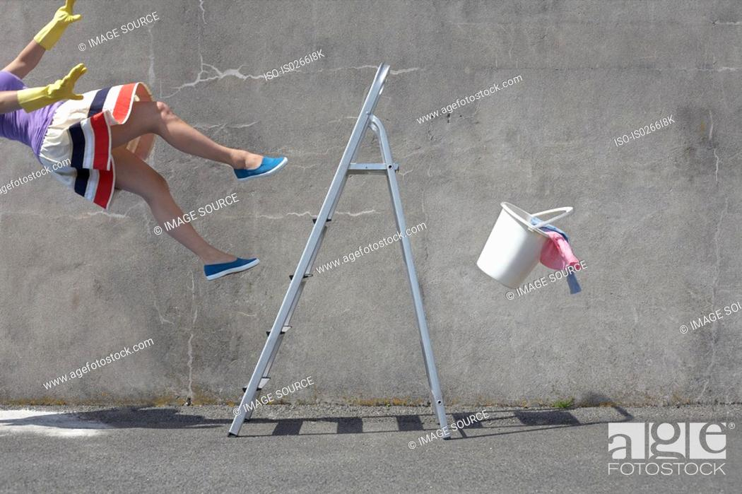 Stock Photo: Woman falling off a ladder.