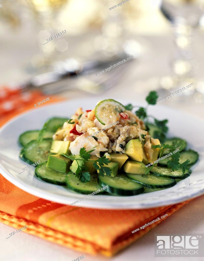 Stock Photo: Flower-shaped sliced cucumber with sea bream and avocado tartare.