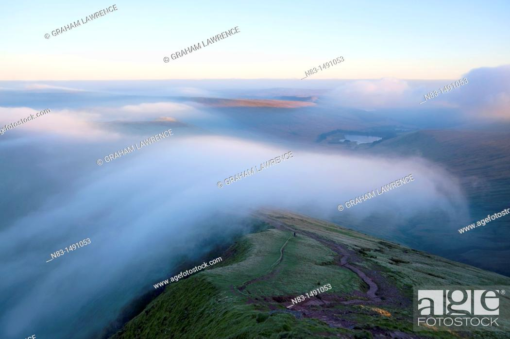 Stock Photo: Orographic cloud forms around the summit of Pen-Y-Fan in The Brecon Beacons National Park, Powys, Wales, UK.