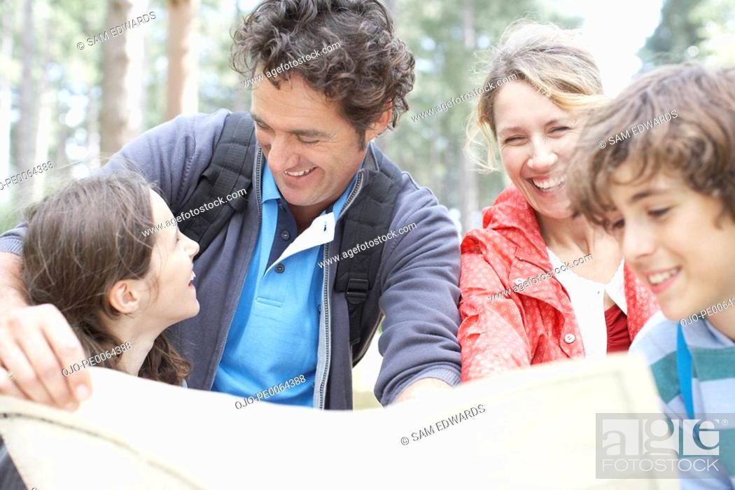 Stock Photo: Family looking at map.