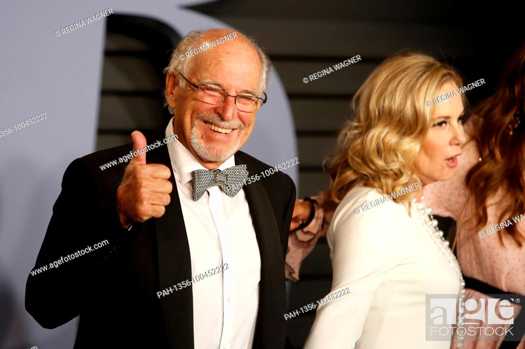 Jimmy Buffett and Jane Slagsvol attending the 2018 Vanity Fair Oscar