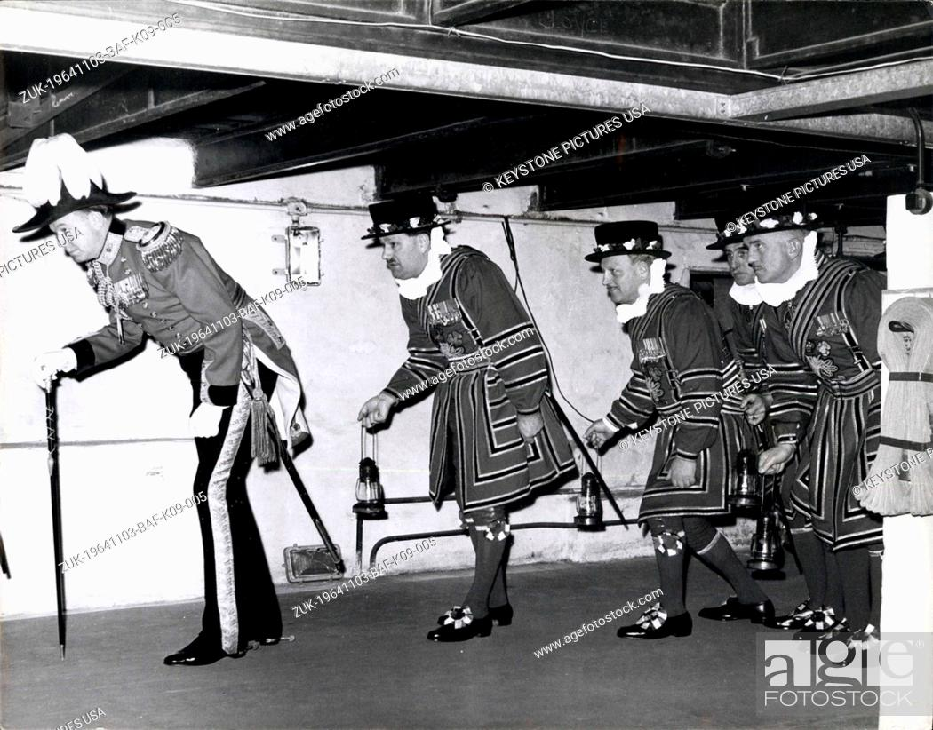 Stock Photo: Nov. 03, 1964 - Preparing the Opening of Parliament. Searching the Vaults.: Ducking beneath the beams - the Beefeaters - or Yeoman of the Guard - to give them.
