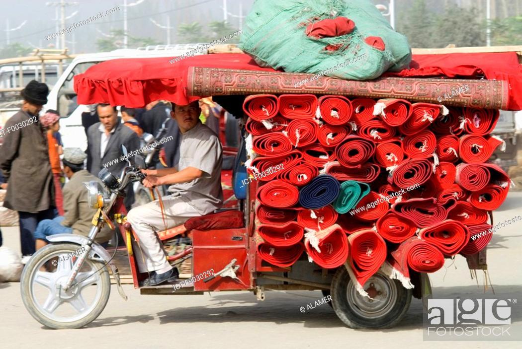 Stock Photo: China, Xinjiang, Keriya, carpets transportation.