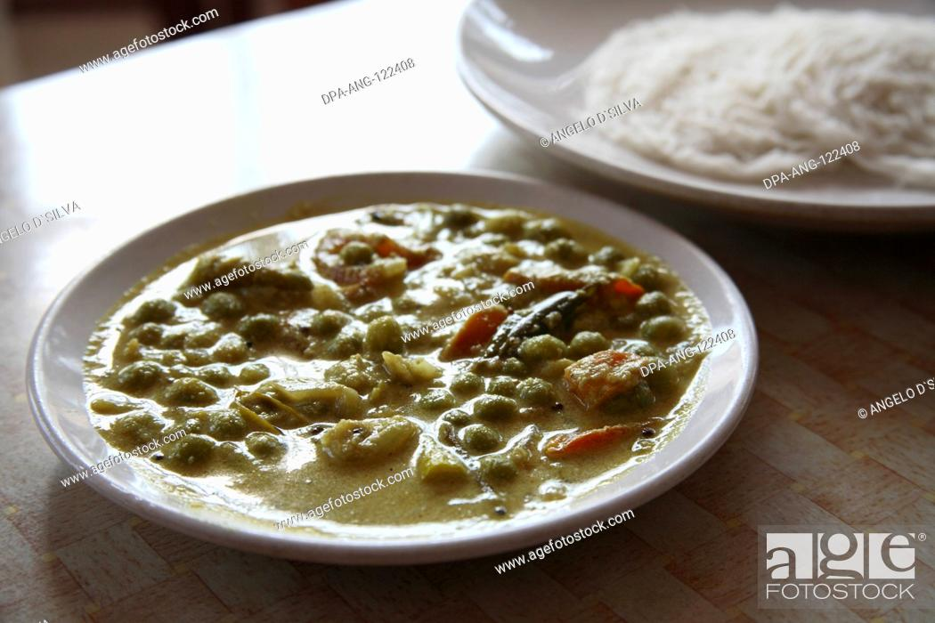 Stock Photo: Food in Kerala ; South Indian mixed vegetable served with Idiappum rice noodles ; Kerala ; India.
