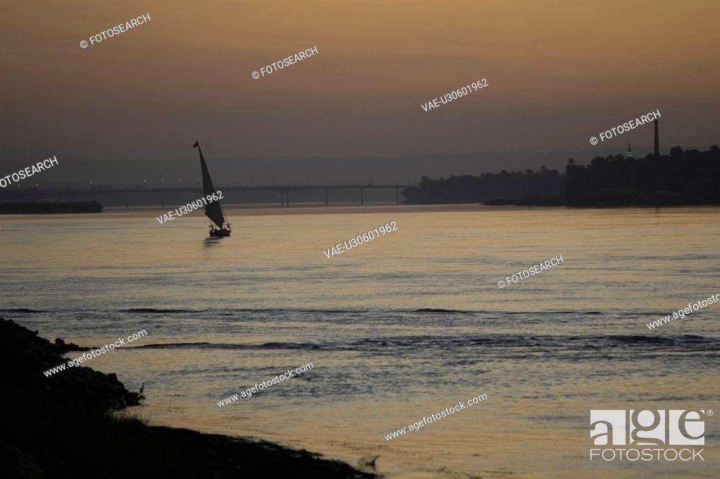 Stock Photo: Coast, Dusk, Floating On Water, Horizon Over Land.