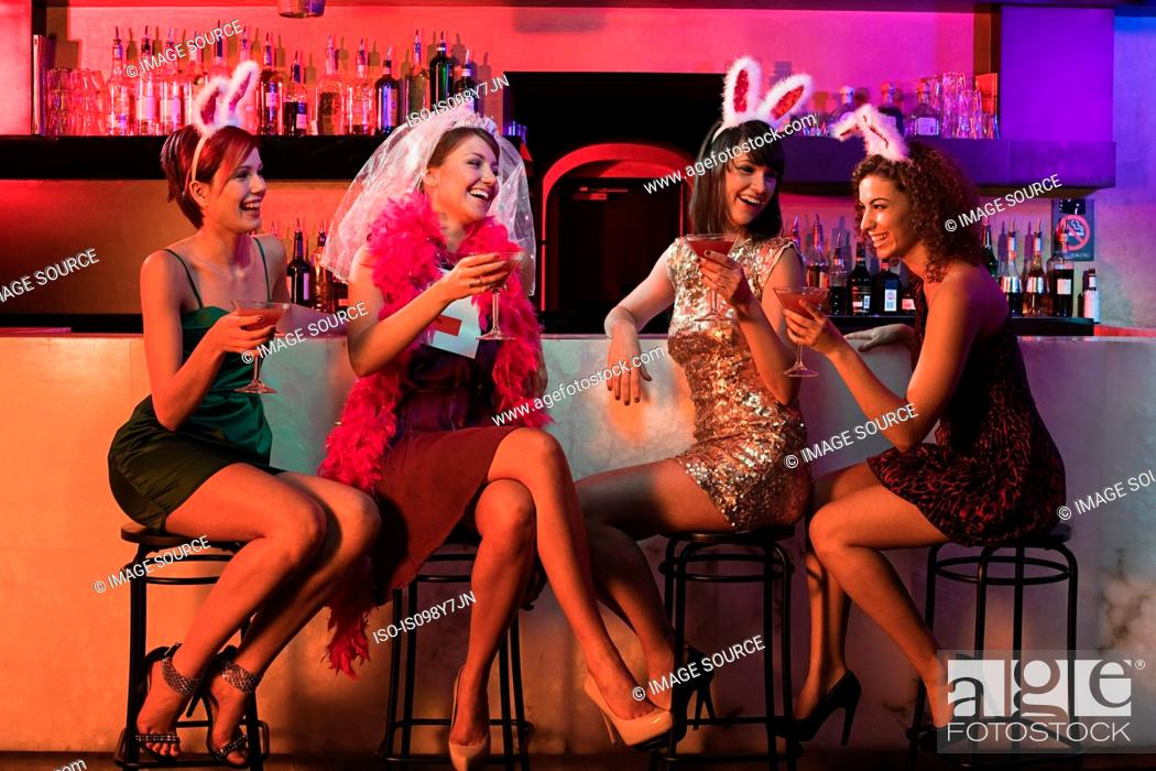 Stock Photo: Four young women on hen night.