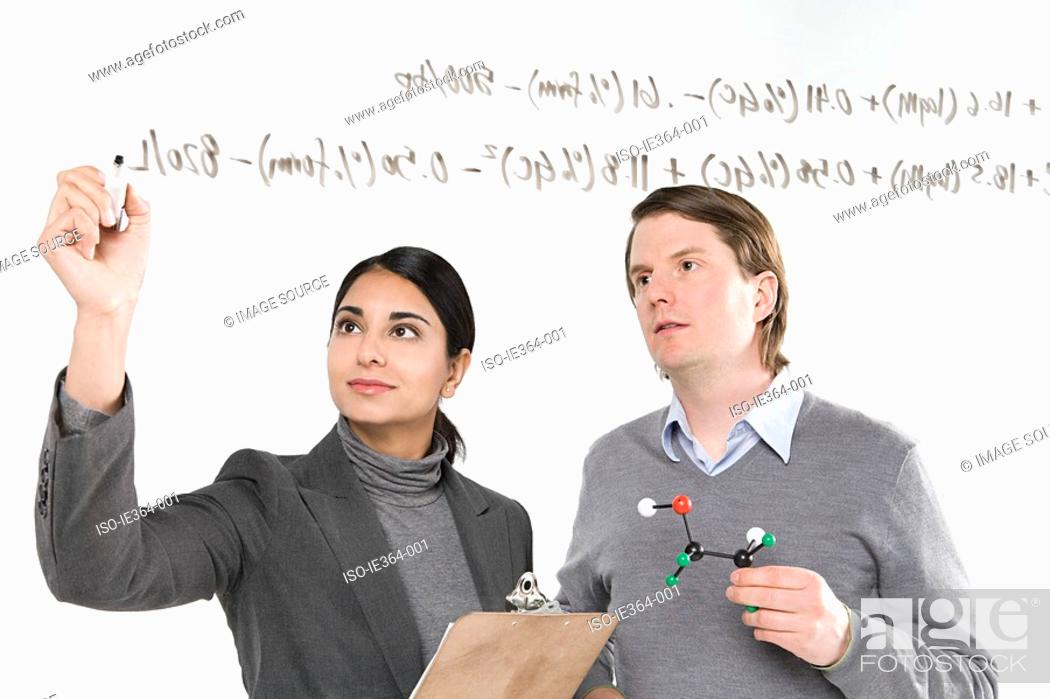 Stock Photo: Scientists with formula.