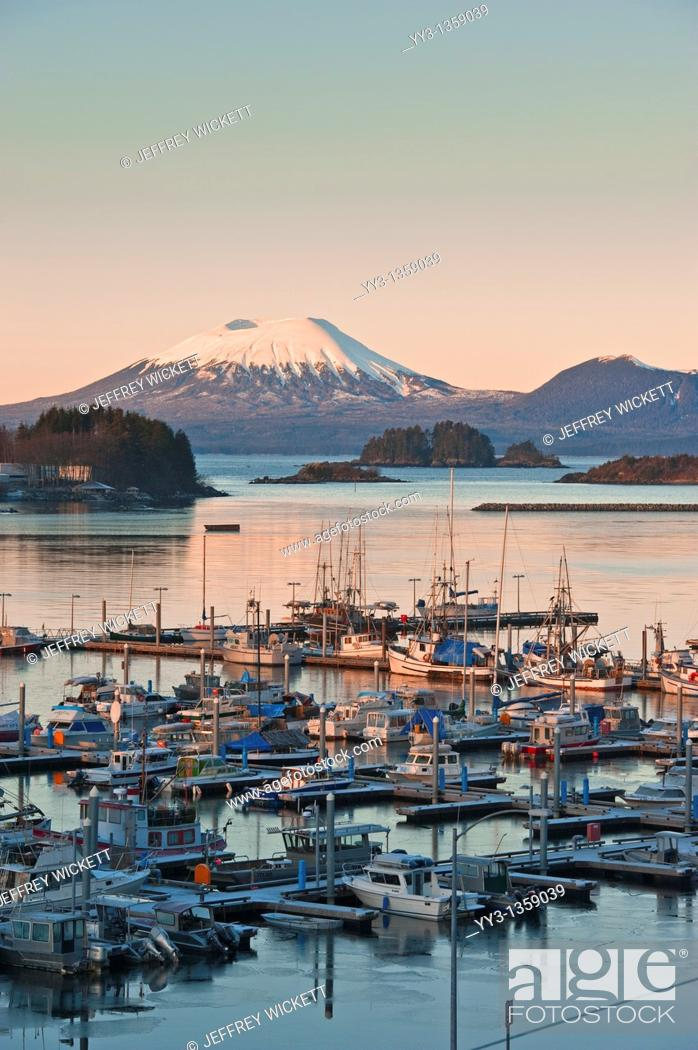 Stock Photo: Sunrise over Thomsen Harbor in Alaska  The City and Borough of Sitka is a unified city-borough located on the west side of Baranof Island in the Alexander.