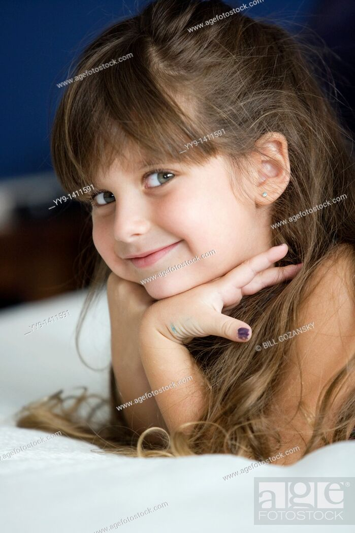 Stock Photo: Young girl posing for camera - Fort Lauderdale, Florida USA.
