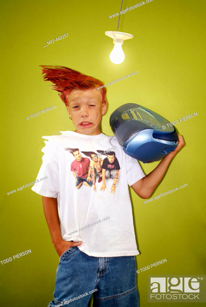 Stock Photo: Kid being blown away by radio. 8 year old boy.