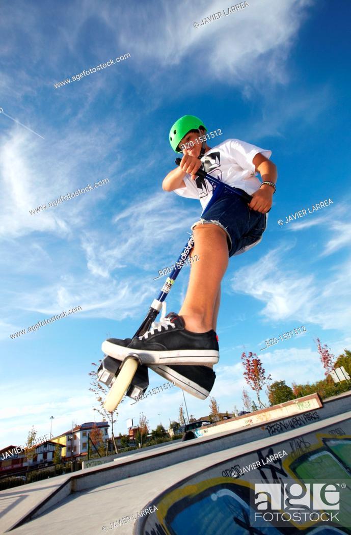 Stock Photo: Teenager with city scooter in Skate park, Irun, Gipuzkoa, Euskadi, Spain.