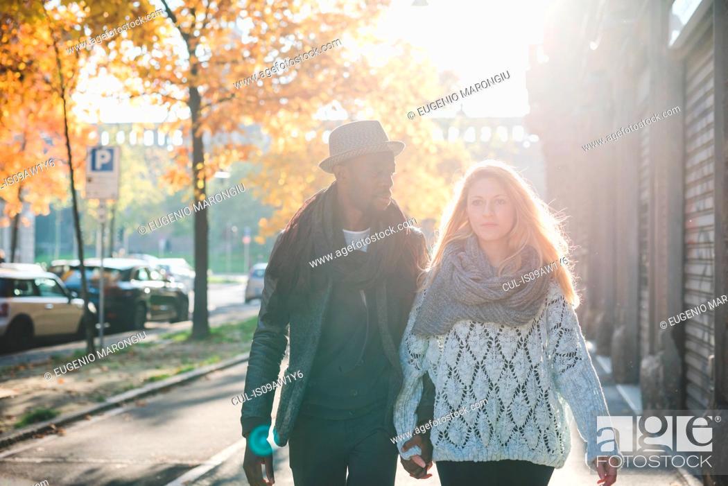 Stock Photo: Couple walking on pavement.