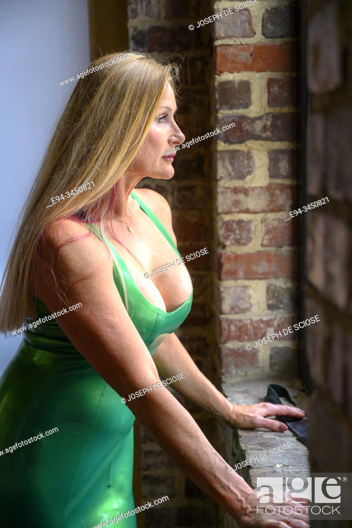 Stock Photo: A beautiful 50 year old blond woman wearing latex clothing looking away from the camera.