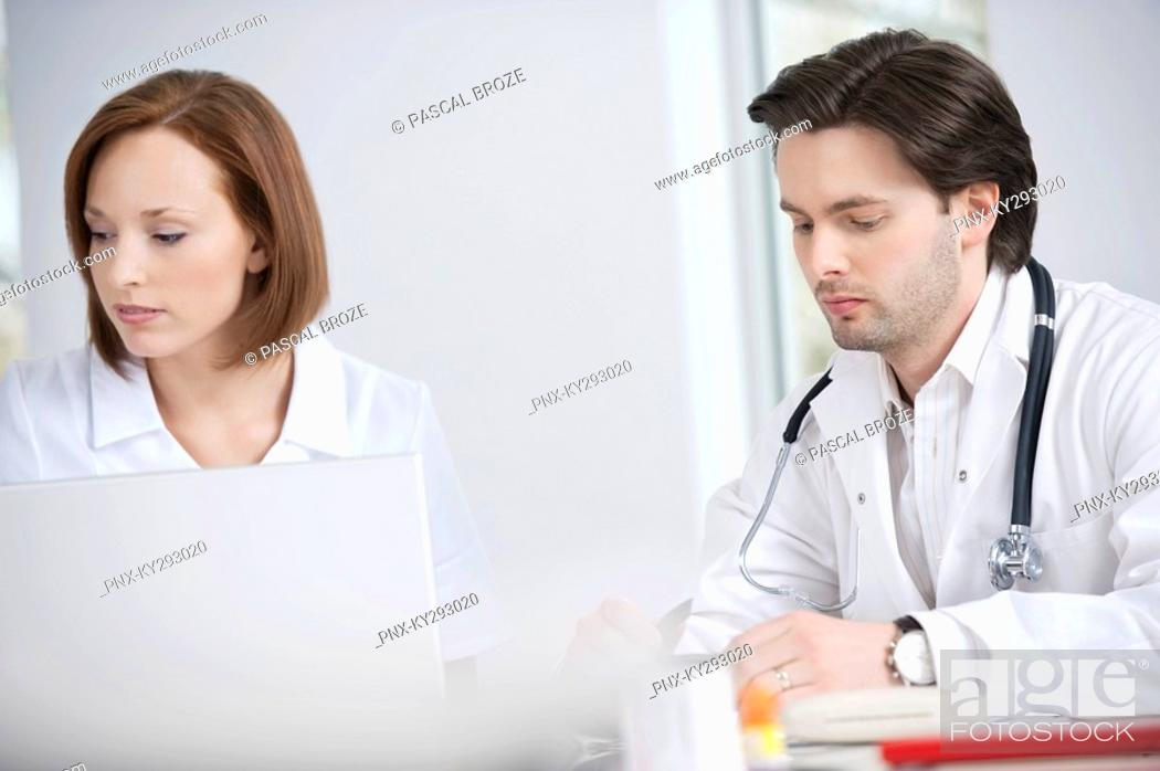 Stock Photo: Doctors working in an office.