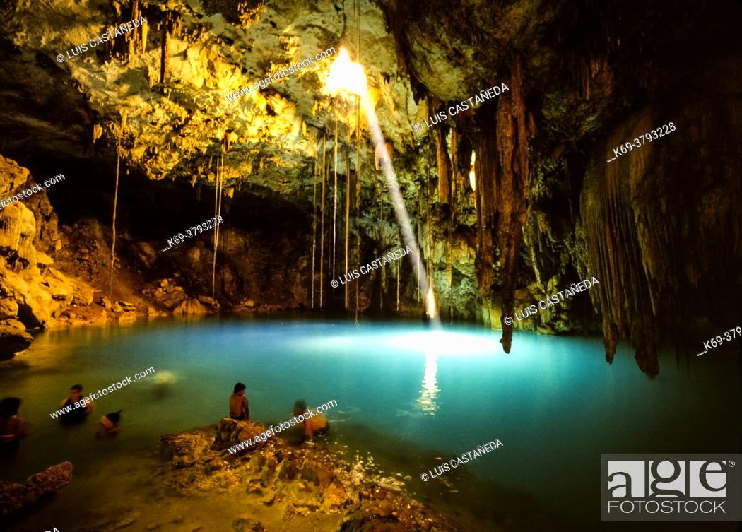 Stock Photo: Cenote Xkeken. Yucatan. Mexico. . Despite their obvious aesthetic attraction, the Cenotes in the region have a fascinating history.