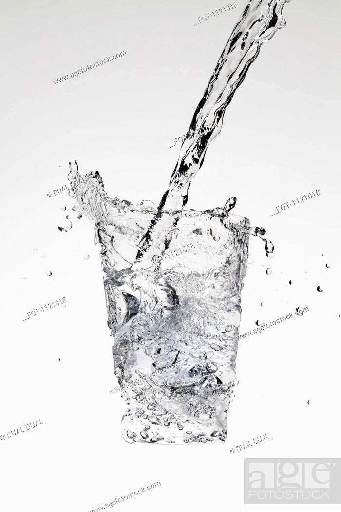 Stock Photo: Water being poured in the form of a glass.