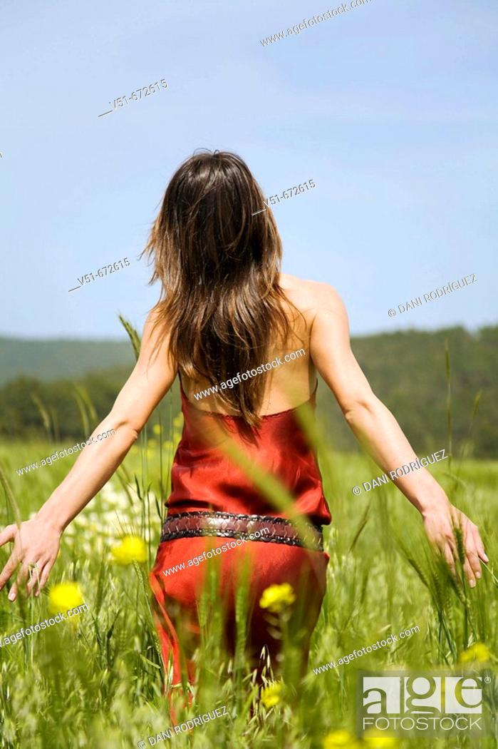 Stock Photo: Woman waliking in the countryside.