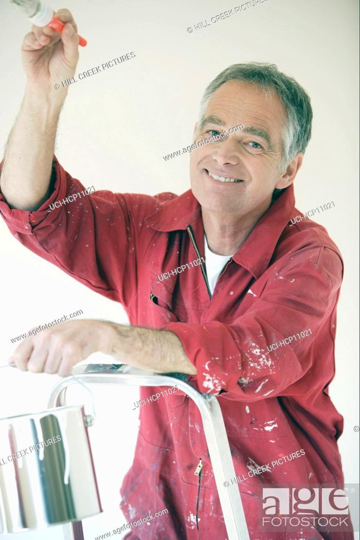 Stock Photo: Man painting.