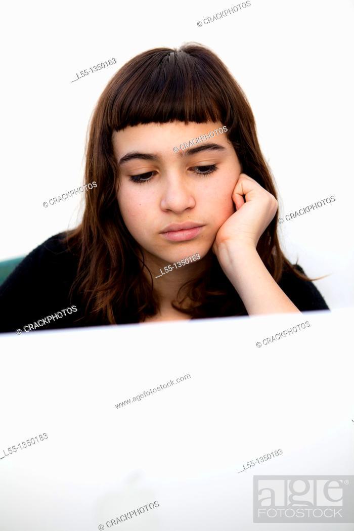 Stock Photo: Bored girl studying.