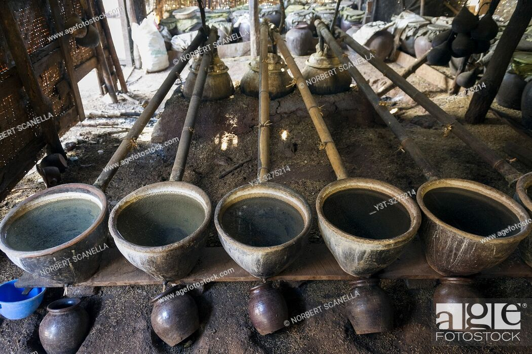Stock Photo: Myanmar (ex Birmanie). Inle lake. Shan state. The Intha, an ethnic group of Inle Lake, live in about 40 lake villages around the lake. Distillery.