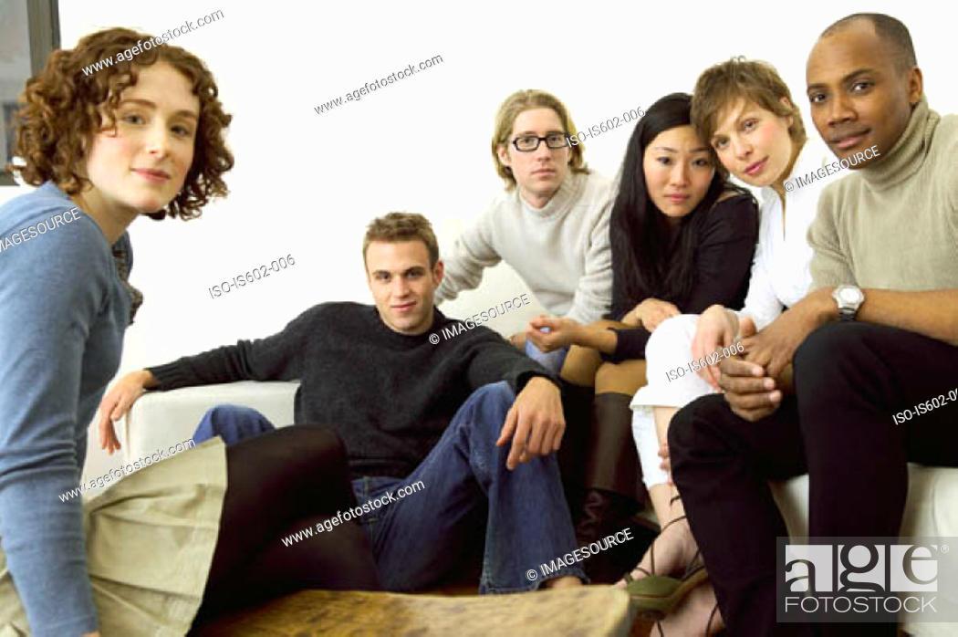 Stock Photo: Portrait of friends on sofa.