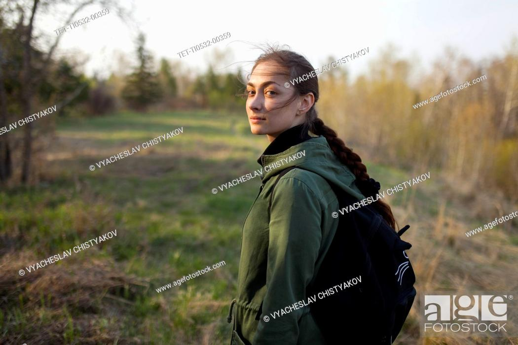 Stock Photo: Russia, Omsk, Young woman in meadow.