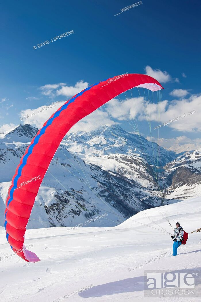 Stock Photo: A Paraglider pilot get ready for take off.