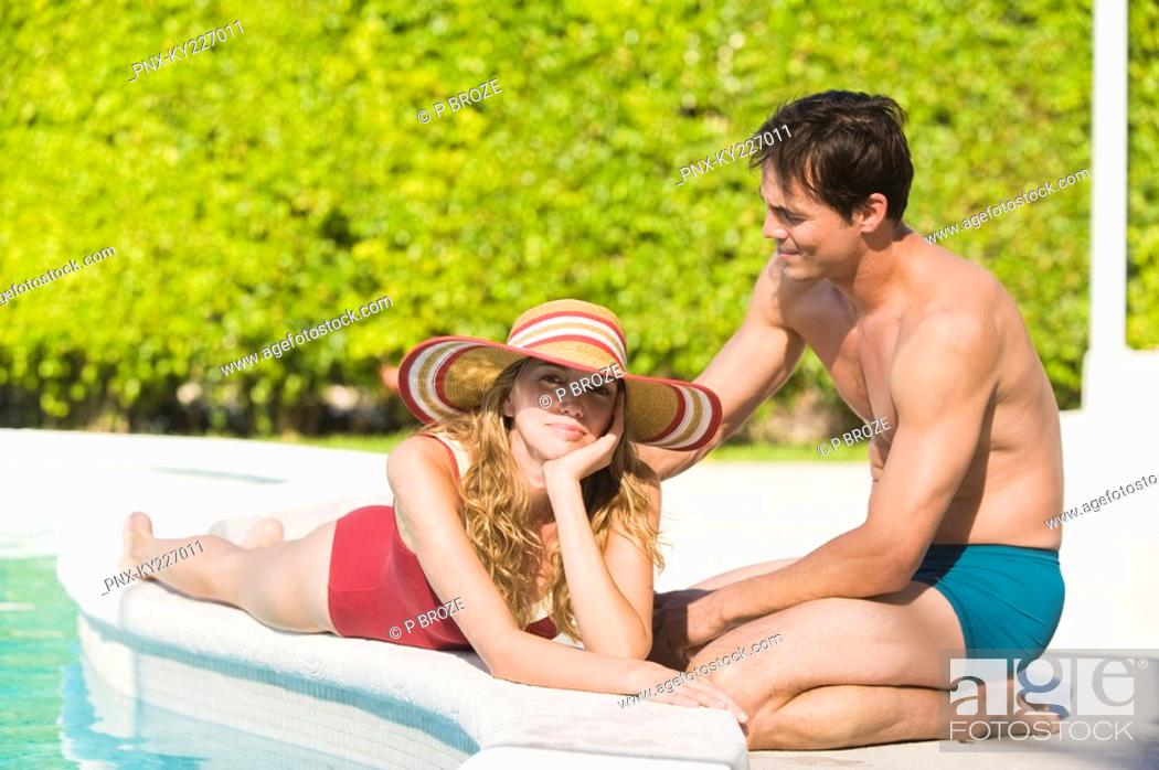 Stock Photo: Couple at the poolside.