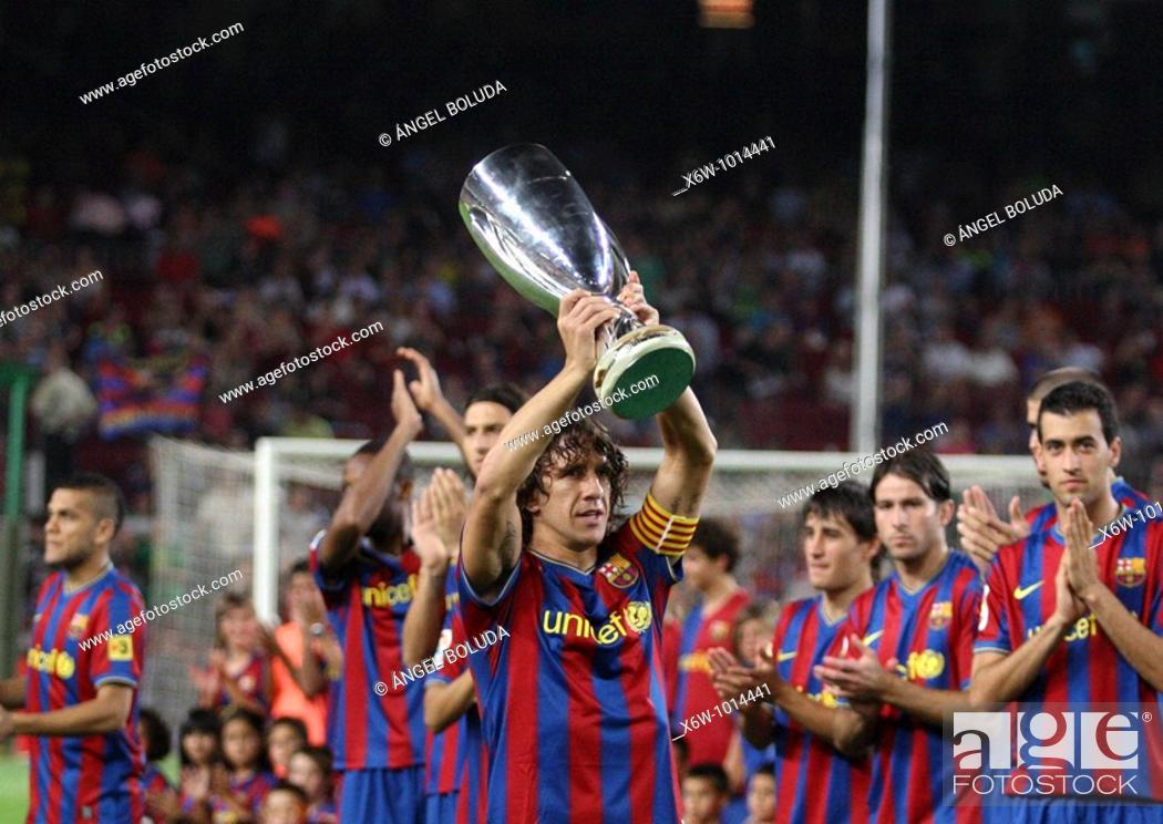 Stock Photo: Barcelona, Camp Nou Stadium, 31/08/2009, Carles Puyol, team captain of FC Barcelona, offering recently won UEFA Super Cup to the supporters.