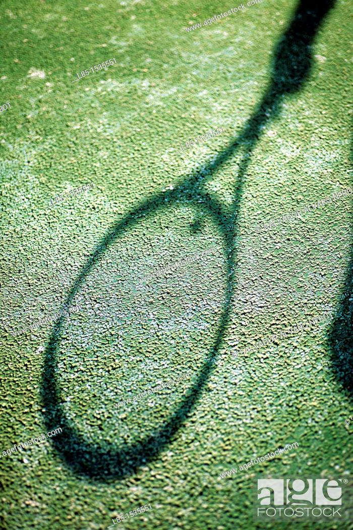 Stock Photo: Projected shadow of a tennis racket.