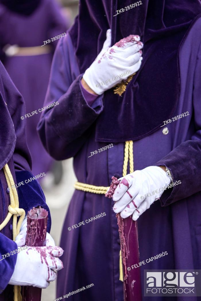 Stock Photo: Detail penitent white holding a candle during Holy Week, Spain.