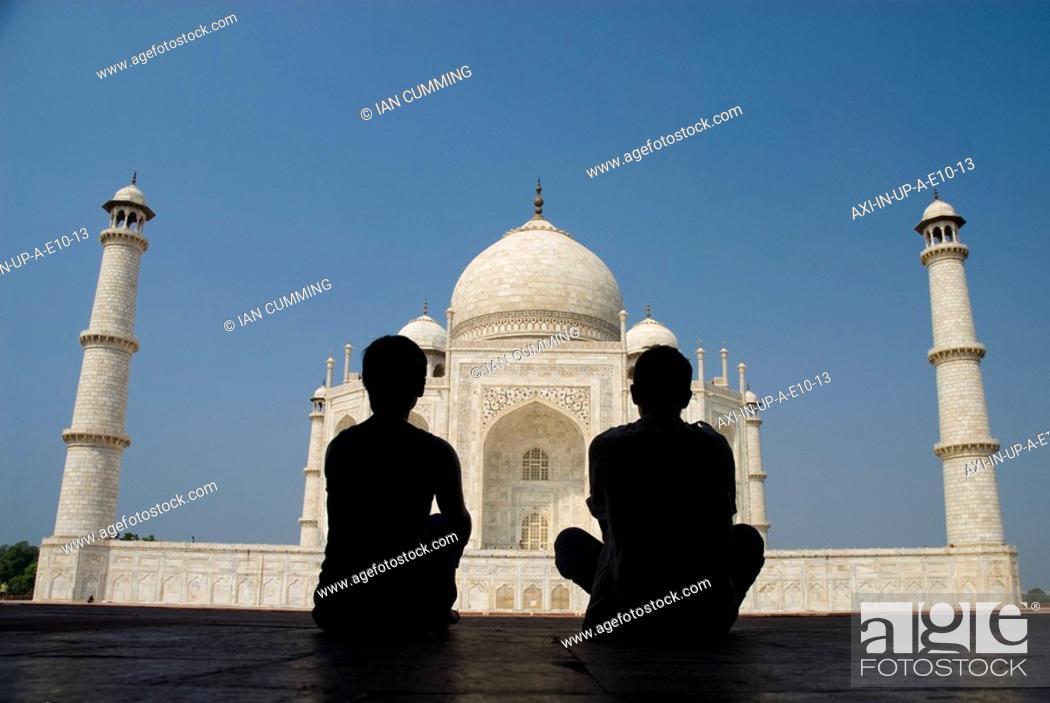 Silhouette Of Couple Admiring The Taj Mahal Stock Photo