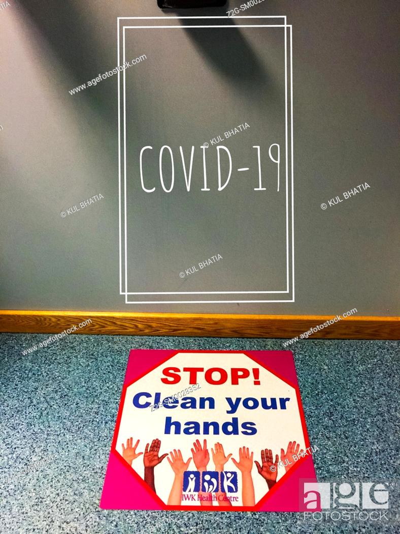 Stock Photo: Advisory sign for Covid-19, best practice, wash hands frequently, Canada.