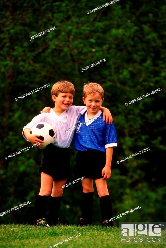 Stock Photo: two boys posing in soccer uniforms.
