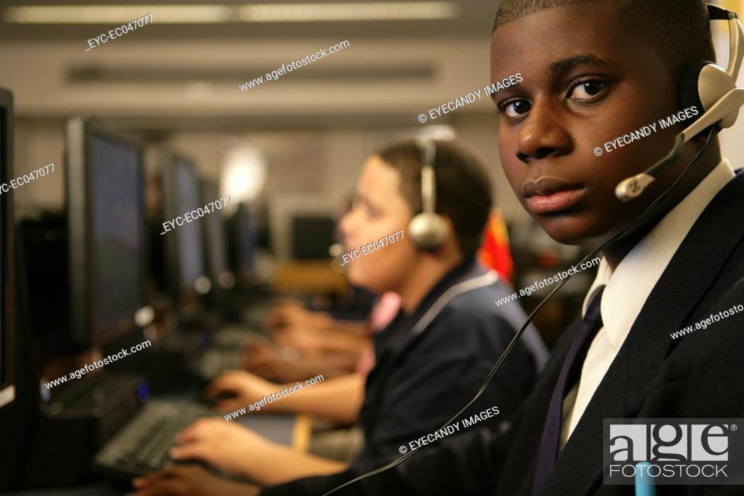 Stock Photo: Boys 11-13 wearing headphones, portrait.