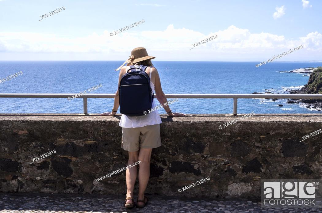 Stock Photo: Woman in lookout, Aci Castello, Catania, Sicily, Italy.