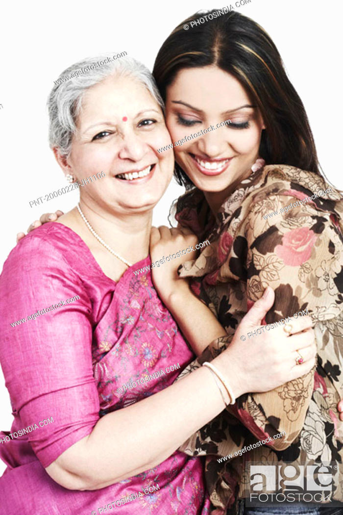 Stock Photo: Portrait of a grandmother hugging her granddaughter.