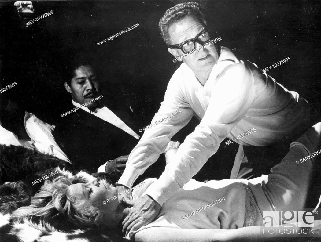 Stock Photo: ALL NIGHT LONG Director BASIL DEARDEN demonstrates to PAUL HARRIS how to strangle MARTI STEVENS.