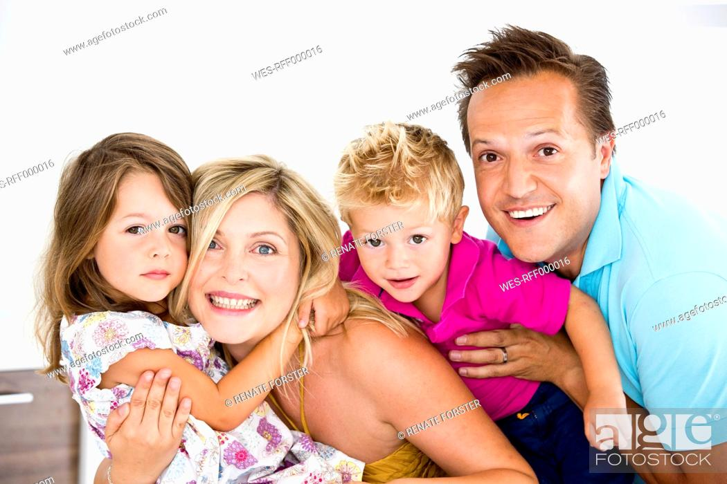 Stock Photo: Germany, Close up of family, smiling, portrait.