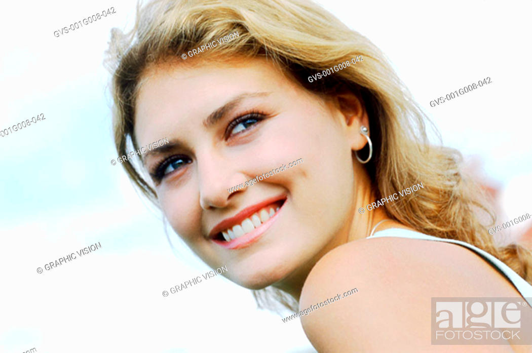 Stock Photo: Side profile of a young woman looking back.