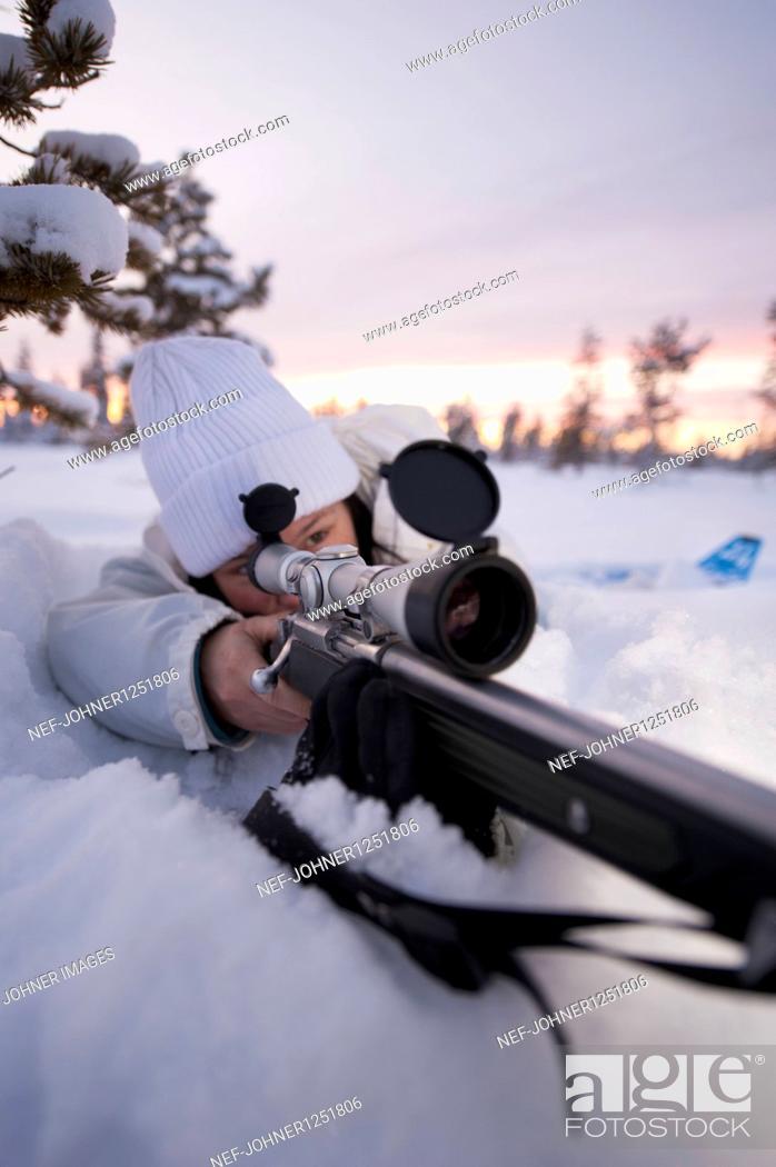 Stock Photo: A woman with a sportinggun.