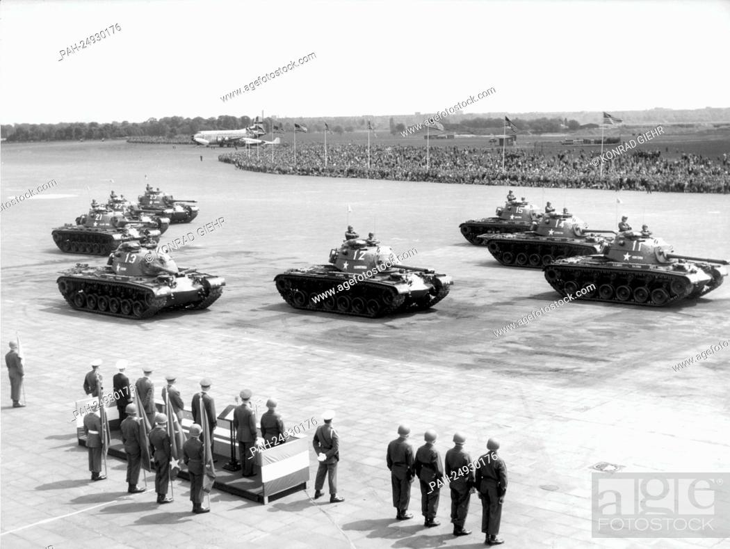 Stock Photo: A tank company driving past a VIP stand on the grounds of airport Tempelhof in West Berlin on occasion of a military parade of the US Army for the 'Armed Forces.