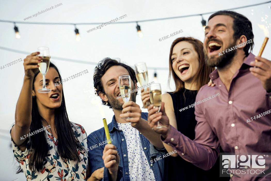 Stock Photo: Friends drinking champagne together outdoors.