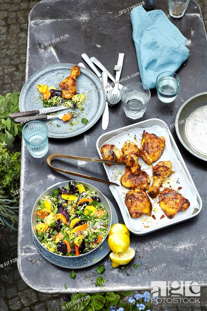 Stock Photo: Grilled chicken legs in buttermilk marinade and couscous with colourful carrots.