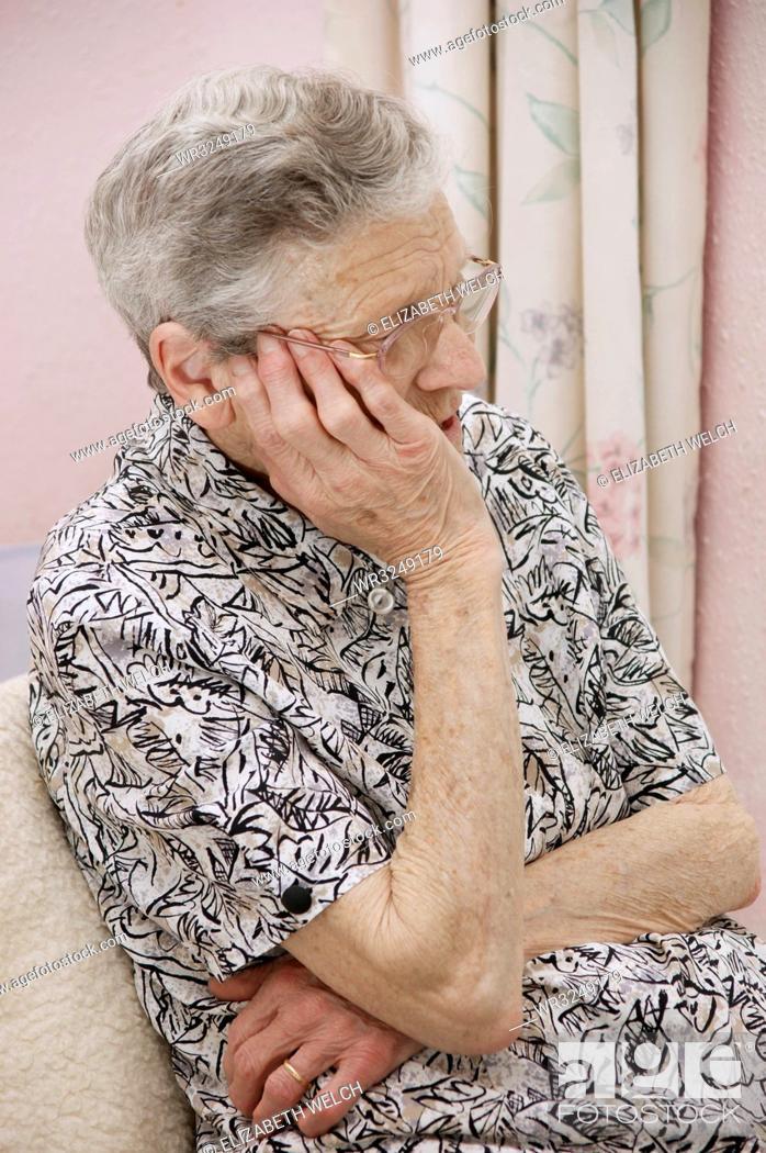 Stock Photo: Vulnerable elderly woman feeling worried.
