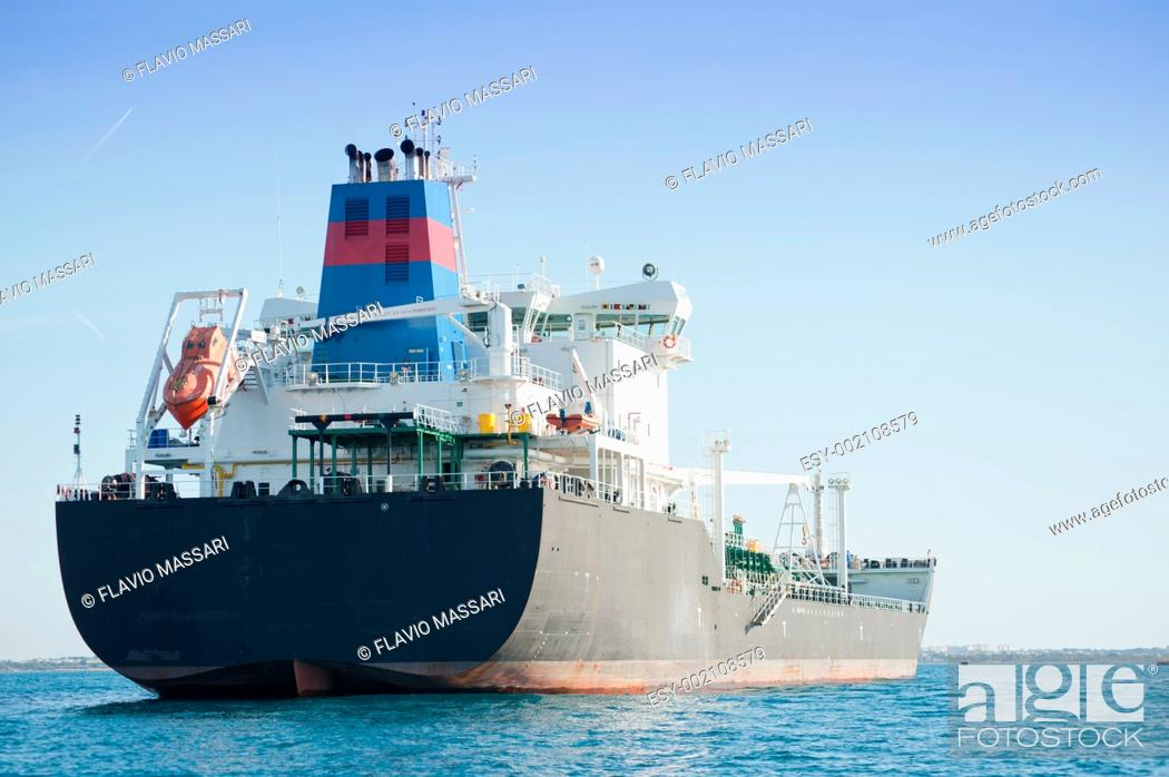 Stock Photo: Ship waiting for the unload in the port Mar Grande, Taranto, Italy.