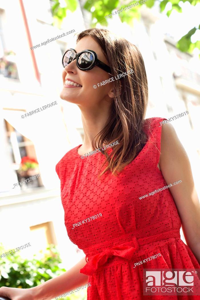 Stock Photo: Close-up of a woman smiling, Paris, Ile-de-France, France.