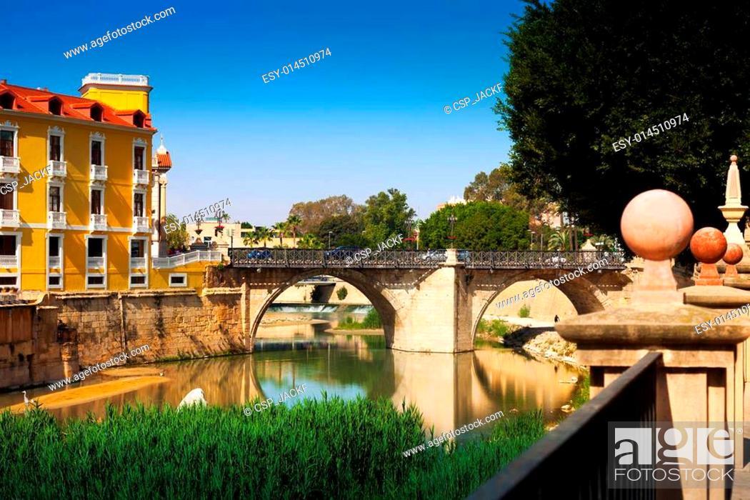 Stock Photo: Old bridge over Segura river in Murcia.
