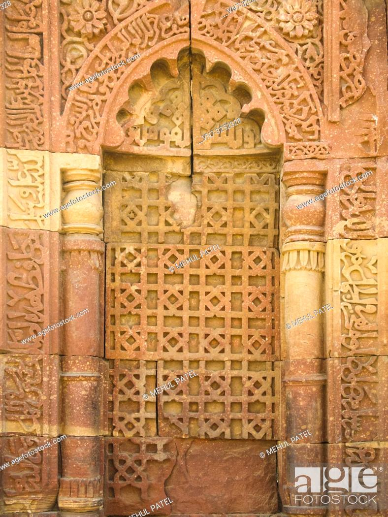 Stock Photo: Close up of detail on exterior of Qutub Minar tower in New Delhi, India, Asia. It is one of the main attractions in the capital city.
