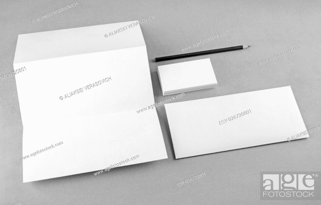 Stock Photo: Photo of blank stationery set on gray background. Mock-up for branding identity. For design presentations and portfolios. Grayscale image.